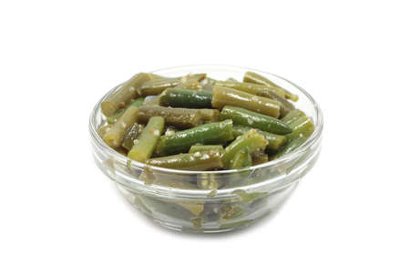 green beans in a glass container on a white background Stockfoto