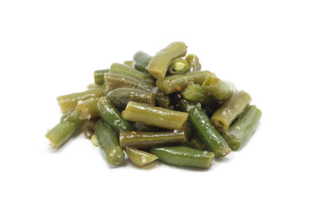 chopped green beans on white background