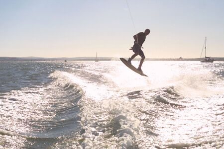 watersport: catching air while wakeboarding