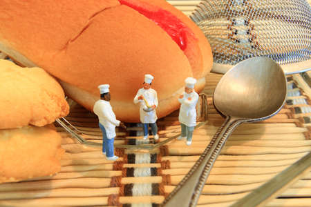 cook: Little cooks are taking in bakery house. Stock Photo