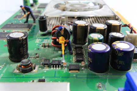 s video: Little workers are repairing the old graphic card.