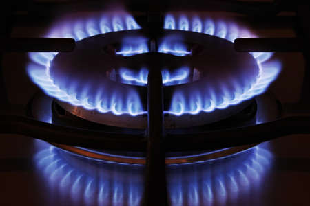 home cooker, flame and reflexes of a methane gas burner Imagens