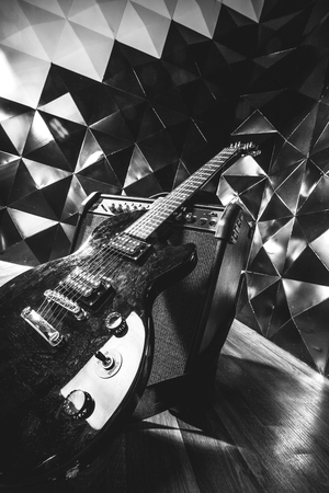amp: electric guitar and classic amplifier on a dark background Stock Photo