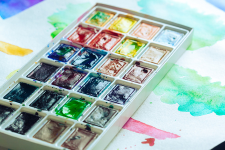 multiple: Set of watercolor paints and paintbrushes for painting
