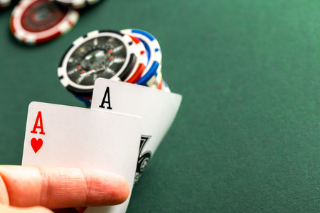 lear: Cards and chips for poker on green table