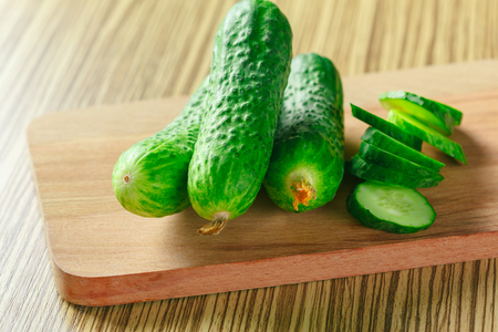 cucumbers on wooden background Stock Photo