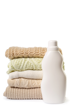 highboy: Stack of various sweaters isolated on white background Stock Photo