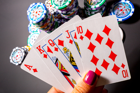 gambler: poker chips and cards on black background