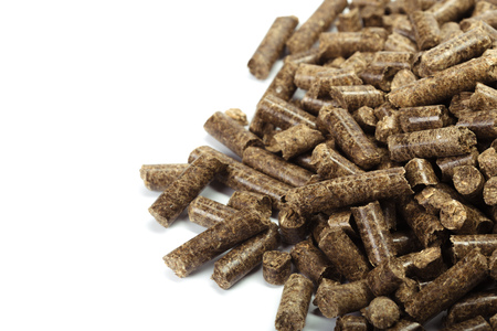 granule: stack of wooden pellets for bio energy, white background, isolated