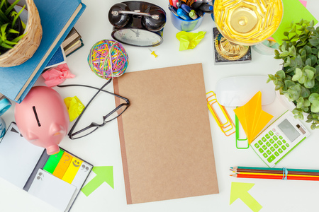envelope: Work place of a creative person with a variety of colorful stationery objects
