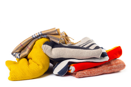 messy clothes: Stack of various sweaters isolated on white background Stock Photo