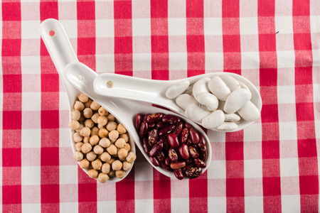 mix of beans on wooden table Stock Photo