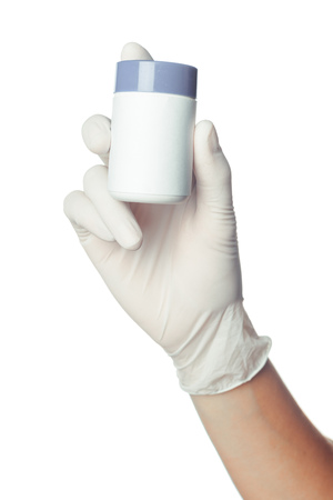 doctors hand in white sterilized surgical glove holding medicine