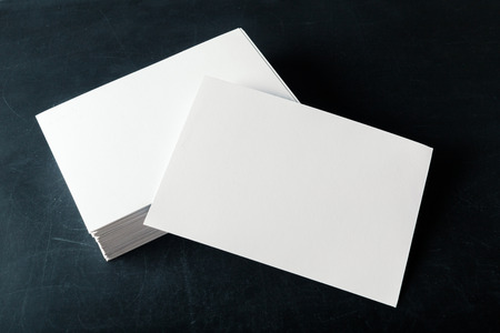 envelope: backed paper blank business cards on the stack