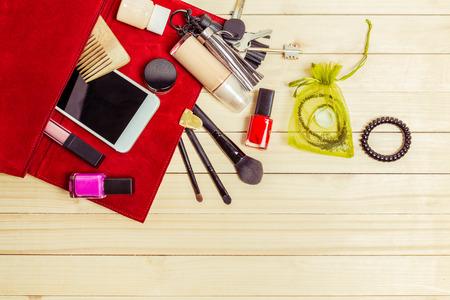 stuff: View on women bag stuff on wooden background Stock Photo