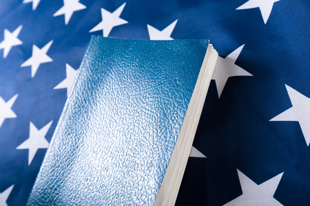 new testament: Bible laying on top of an american flag