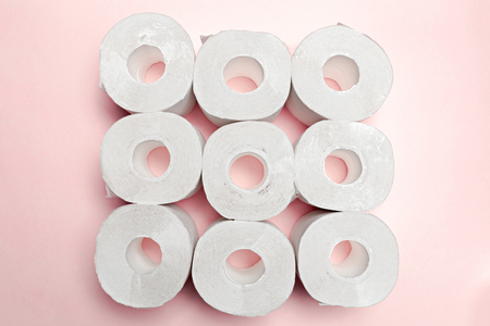 Toilet paper on pink background Stock Photo