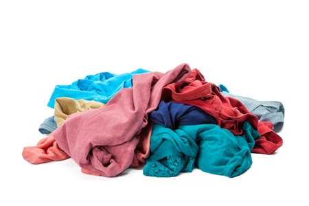 Stack of clothes on white background, closeup