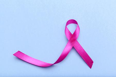 ribbon HIV, AIDS on blue background Stock Photo