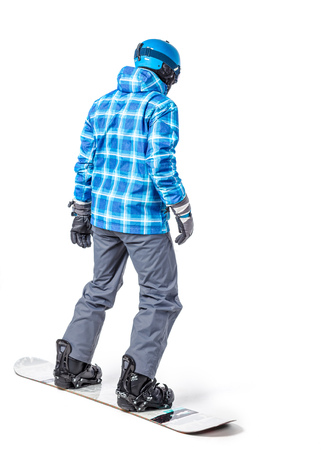 Portrait of young man in sportswear with snowboard isolated on a white background. Stock Photo