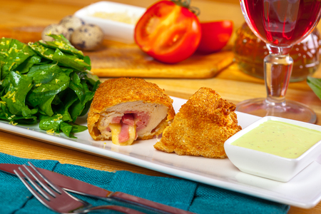 Breaded cutlet served on a plate