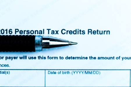 cpa: US tax form with pen