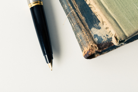 Vintage books and pen Stock Photo