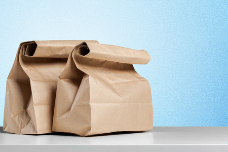 simple brown paper bag for lunch or food on table Stock Photo