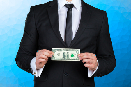 Unrecognizable businessman shows dollar banknote Stock Photo