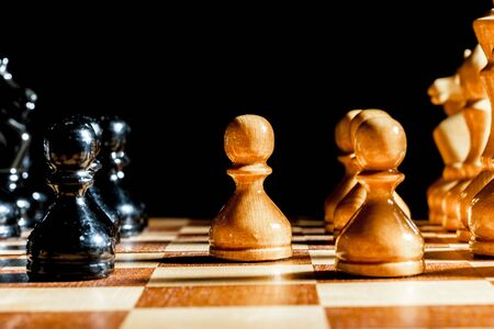 chessman: chess pieces on a black background