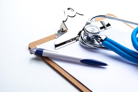 prescription pad: Empty prescription  lying on table with stethoscope