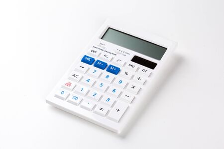 addition: Top view of a calculator isolated on white background