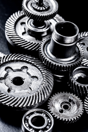 interlink: Metal gears on black background