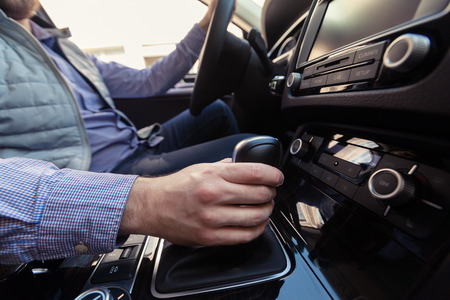 Hand Pushing the power button to turn on the car stereo system Stock Photo