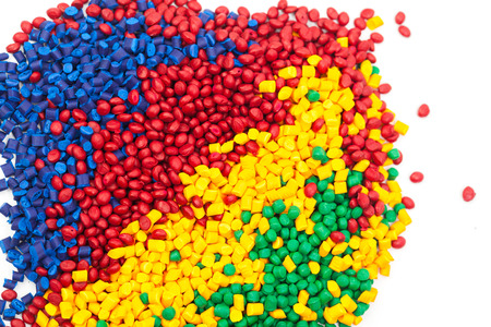 moulding: tinted plastic granulate for injection moulding process Stock Photo