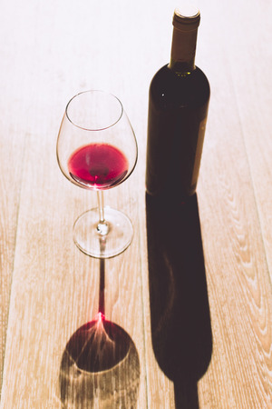 corked: Glass and bottle with red wine