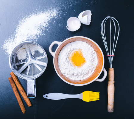 Ingredients and utensil for baking on the black board, top view