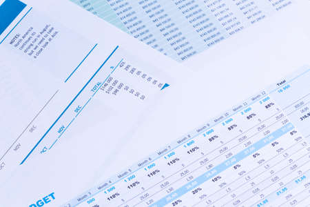 investment concept: Financial paper charts and graphs on the table