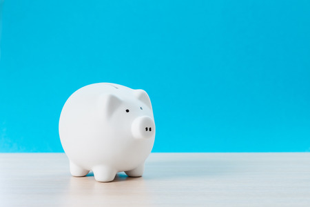 Piggy bank on wooden table Stock Photo