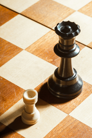 Small wooden chess pieces Stock Photo