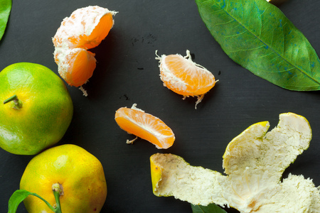 clementines: Mandarins on a black background