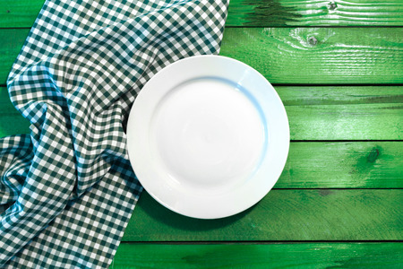 round chairs: the plate on checkered table cloth Stock Photo