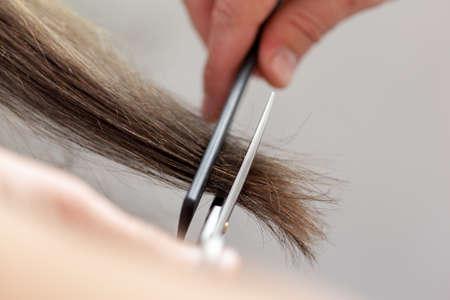 haircutter: Woman does a haircut Stock Photo