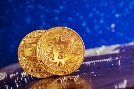Bitcoin and a computer graphic card 版權商用圖片 - 77397116