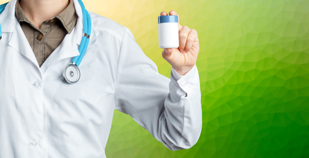 Doctor holding pills Stock Photo