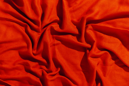 tejido de lana: Red scarf over black wood table background