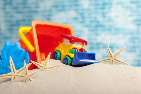 Childrens toys on sand Stock Photo