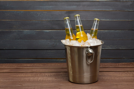 Bucket of Beer on Wooden table Stock Photo