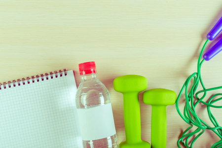 Workout plan and sports equipment Stock Photo