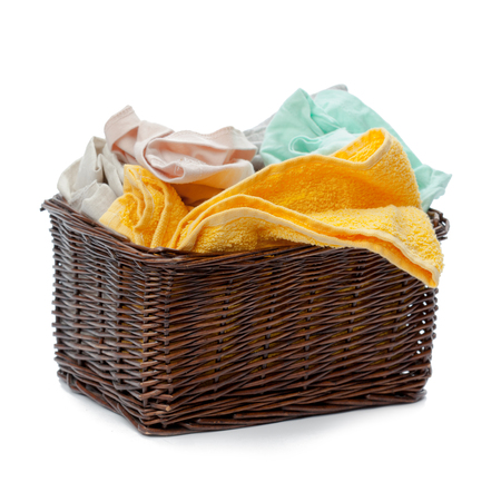 bulk: Clothes in a laundry wooden basket isolated on white background Stock Photo